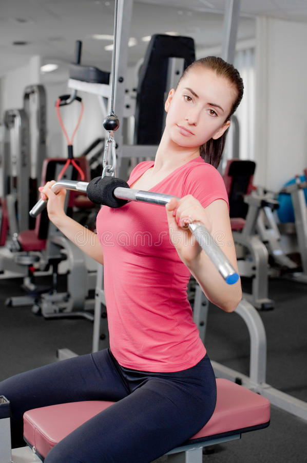 Young woman in a fitness center royalty free stock photography