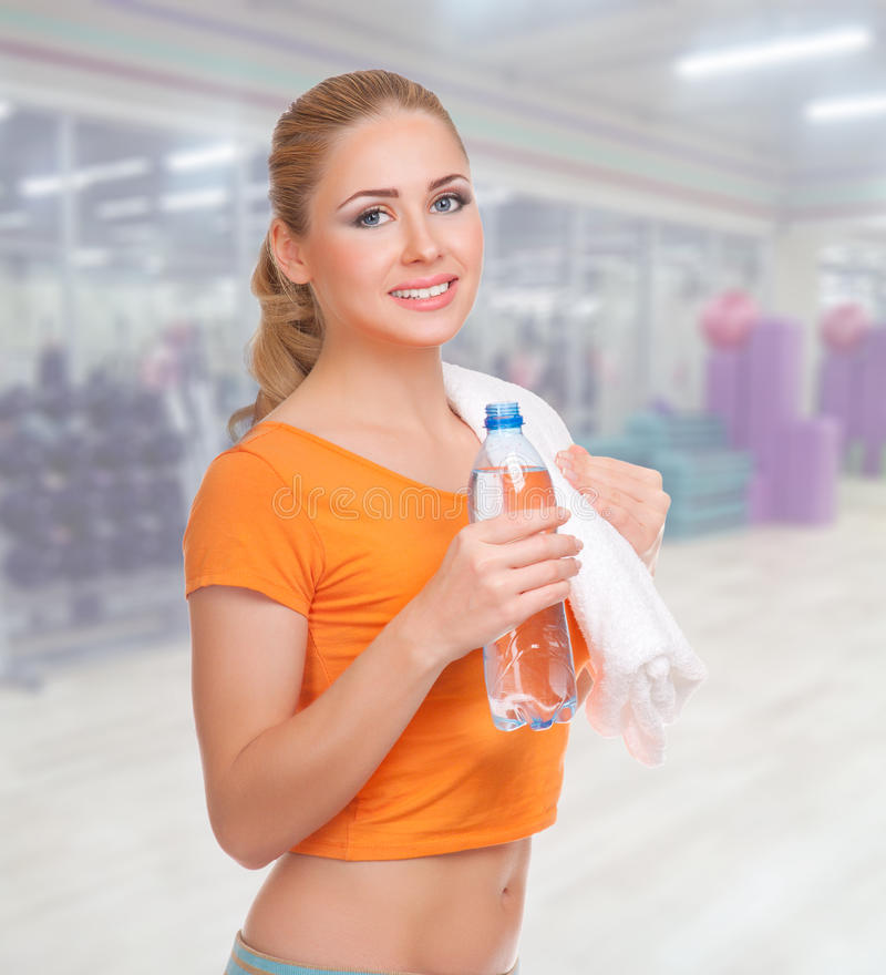 Young woman at fitness club stock images