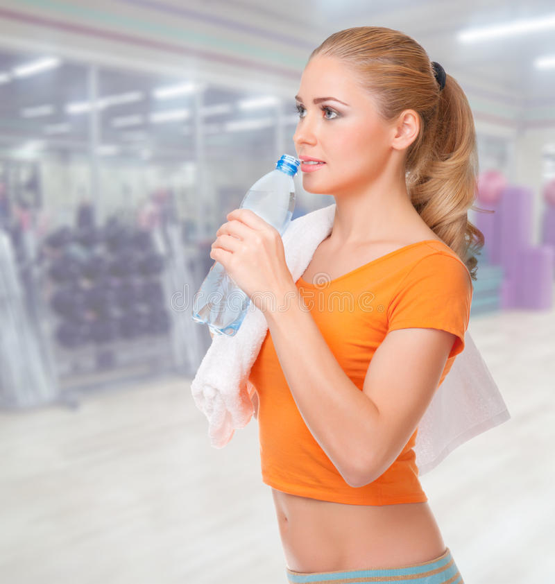 Young woman in fitness club stock images
