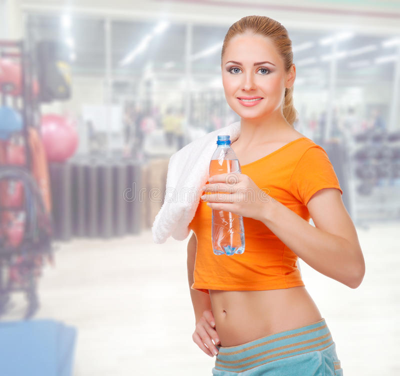 Young woman in fitness club royalty free stock image