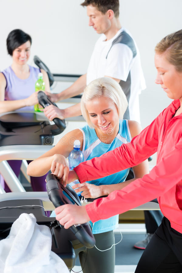 Young Woman On Fitness Treadmill Give Instructions Stock Photos
