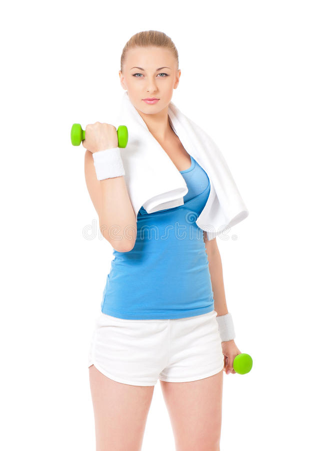 Young woman in fitness wear exercising with dumbbells. Happy young woman in fitness wear exercising with dumbbells and towel, isolated on white background stock image