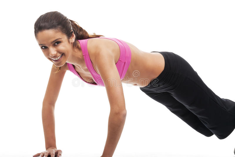 Young woman fitness. Young woman wearing fitness clothes and doing workouts royalty free stock photo