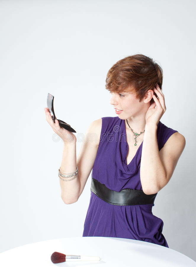 Download Young Woman Fixing Her Hair Stock Image - Image: 21542179