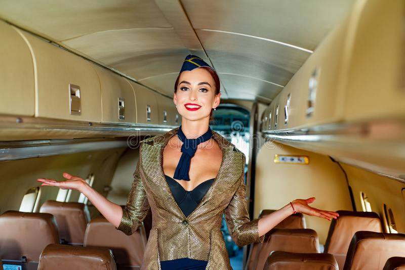 Young woman in flight attendant clothes. Happy smiling woman stewardess in uniform waiting for her flight. Stewardess. And travel time. Woman and commercial stock photos