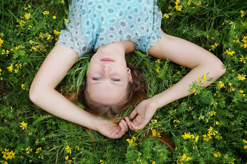 Young woman in a flower meadow stock photo