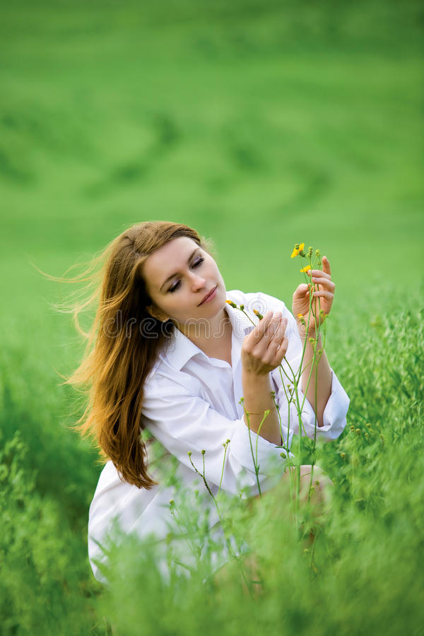 Young woman and flowers. stock photos