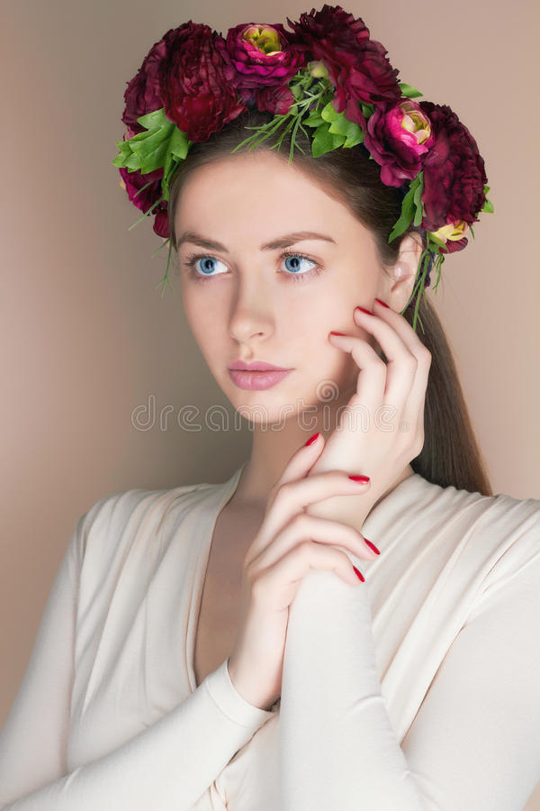 Young woman with flowers crown. Beauty model girl.Beautiful Girl with flowers on her head.Spring hairstyle stock images