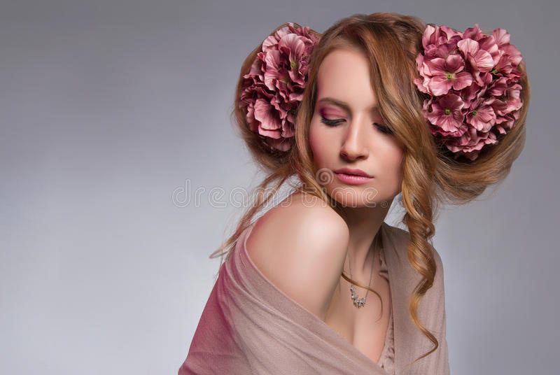 Young woman with flowers in the hair royalty free stock photos