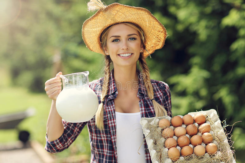 Young woman with fresh organic eggs and milk. Picture of young woman with fresh organic eggs milk stock photography