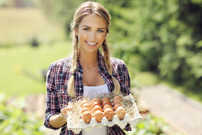 Young woman with fresh organic eggs. Picture of young woman with fresh organic eggs stock photography