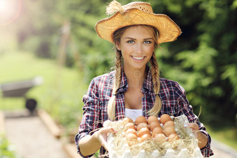 Young woman with fresh organic eggs. Picture of young woman with fresh organic eggs royalty free stock image