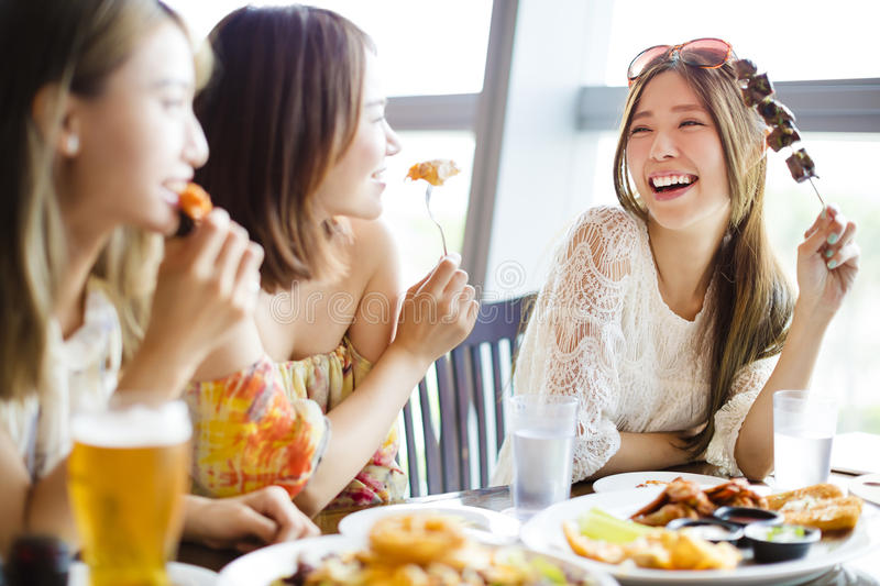 Young woman Friends Enjoying Meal in the Restaurant stock image