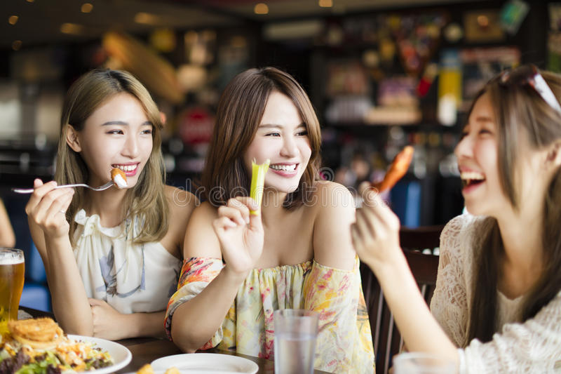 Young woman Friends Enjoying Meal in the Restaurant stock photo