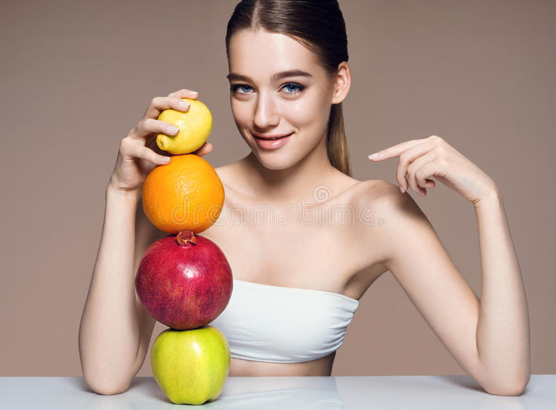 Young woman with fruits mix, healthy life concept . stock photos