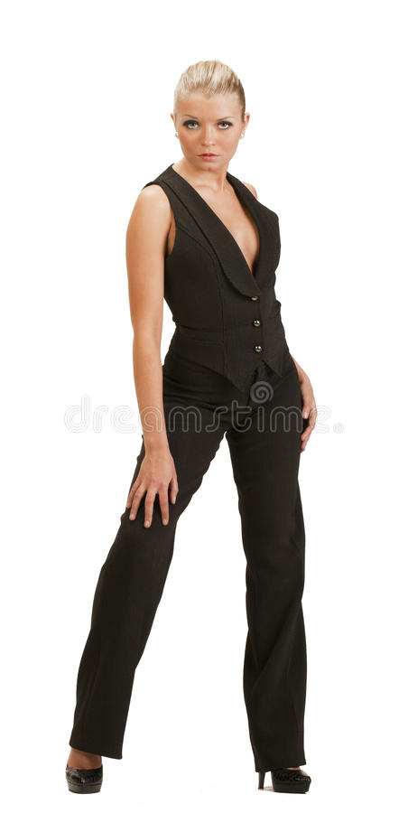 Young woman in a full-length trouser suit posing stock image