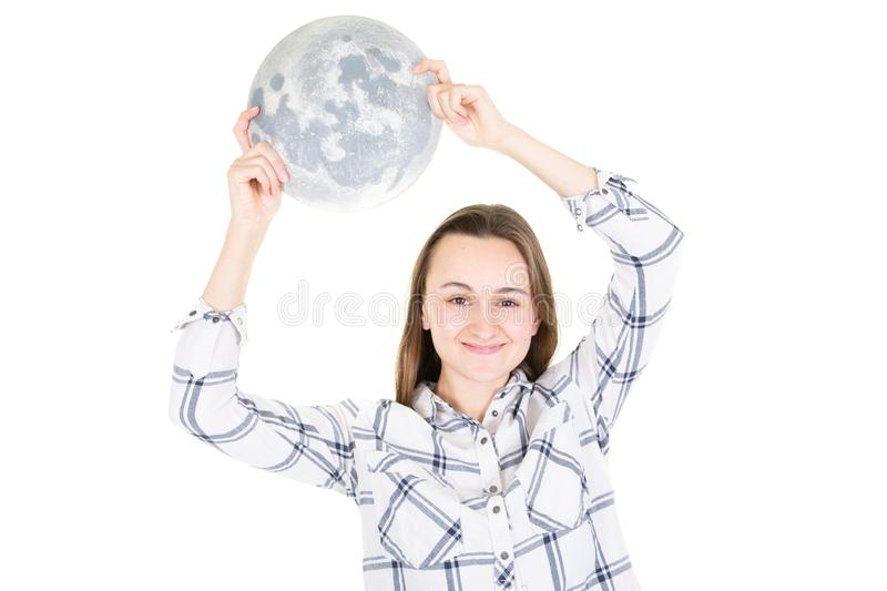 Young woman with full moon in cupped hand on white background royalty free stock images