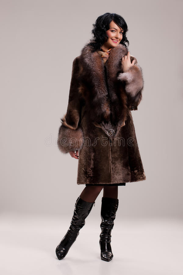 Download Young Woman In A Fur Coat stock image. Image of female - 17767829