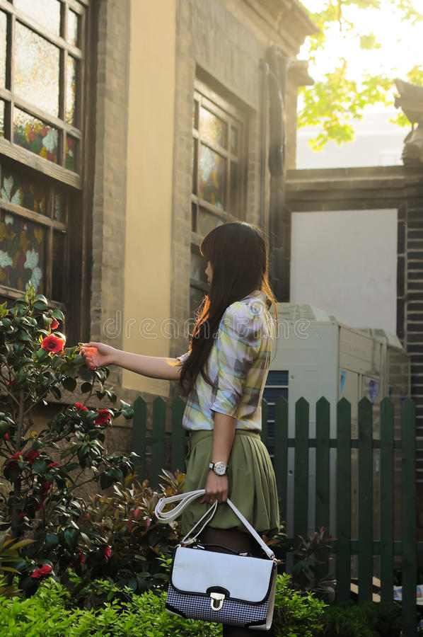 Download A young woman in garden stock photo. Image of flower - 20099554