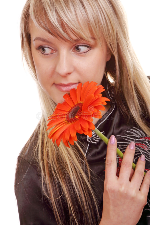 Young woman with gerber flower. Beautiful young woman with gerber flower royalty free stock photo