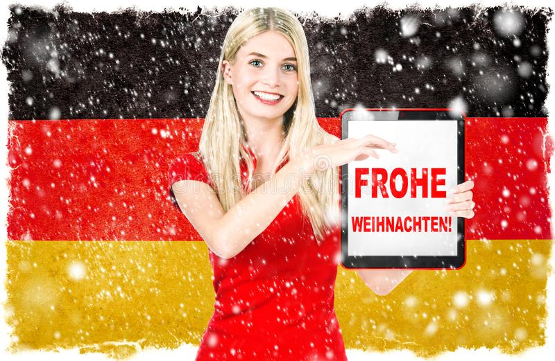 Woman german national flag Merry Christmas Frohe Weihnachten stock photography