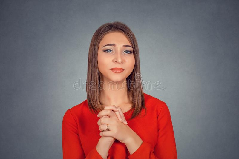 Young woman gesturing with clasped hands thankful stock images