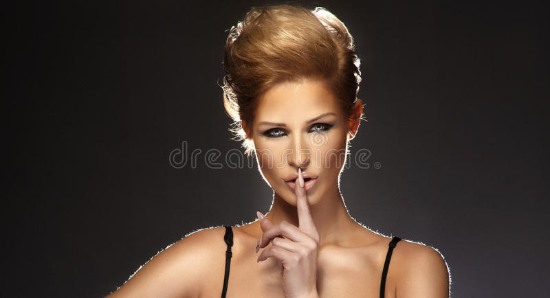Young Woman Gesturing For Quiet Or Shushing Stock Image