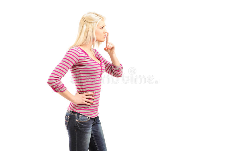 Download Young Woman Gesturing Silence With Finger Over Mouth Stock Photos - Image: 28814793