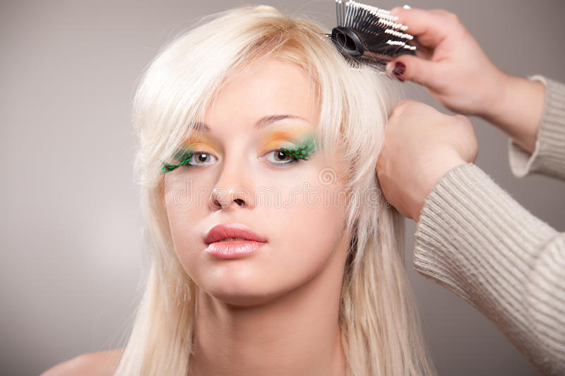 Download Young woman gets a hairdo stock photo. Image of brush - 18899328