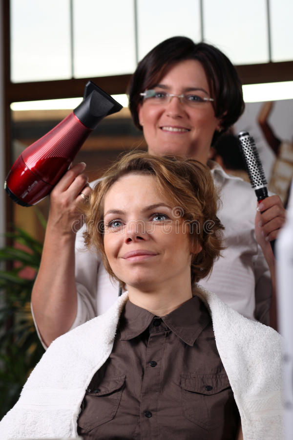 Young woman gets a hairdo in the beauty-