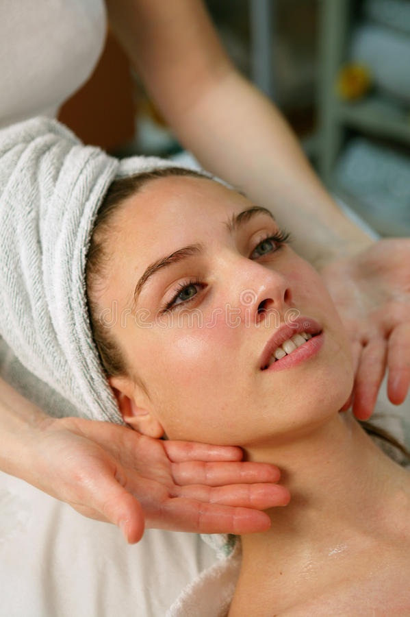 Free Young Woman Getting A Face Massage Royalty Free Stock Photos - 9743378