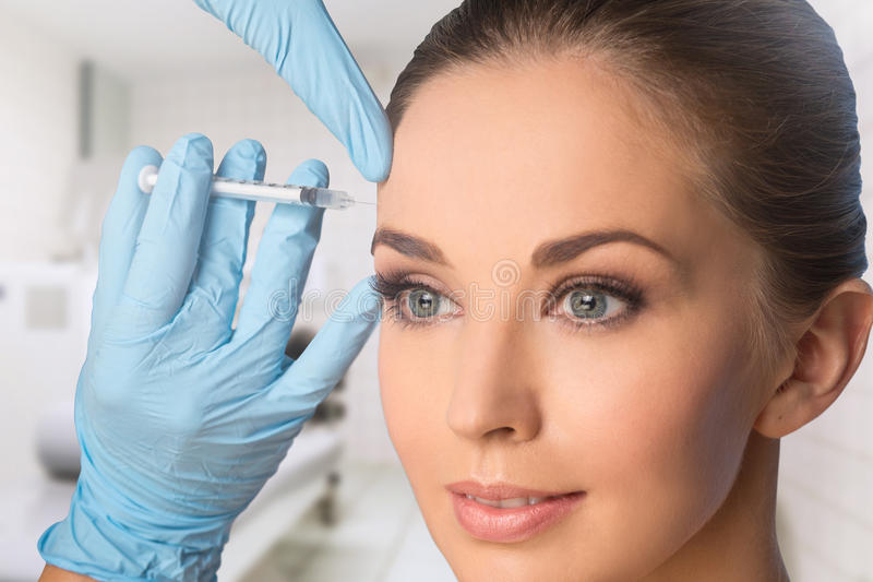 Young woman getting BOTOX injections stock photography