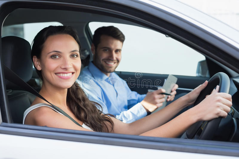 Young woman getting a driving lesson royalty free stock photography