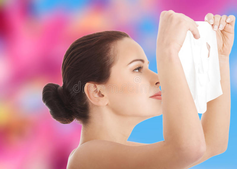 Young woman getting facial mask royalty free stock photography