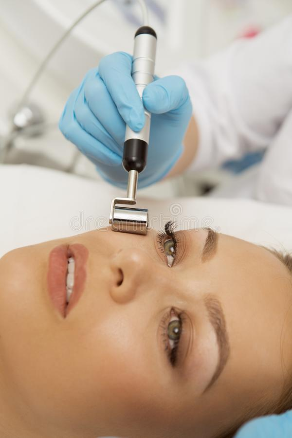 Young woman getting facial treatment at the spa stock photography