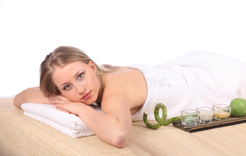 Young woman getting a massage in spa royalty free stock photos