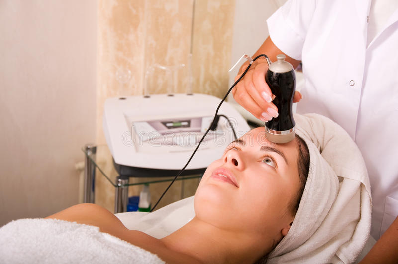 Young woman getting skin cleaning at beauty salon royalty free stock photo