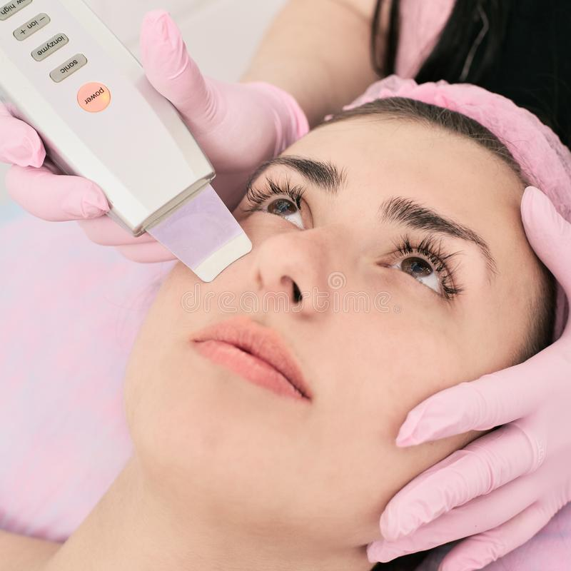 Ultrasound therapy of face stock photography
