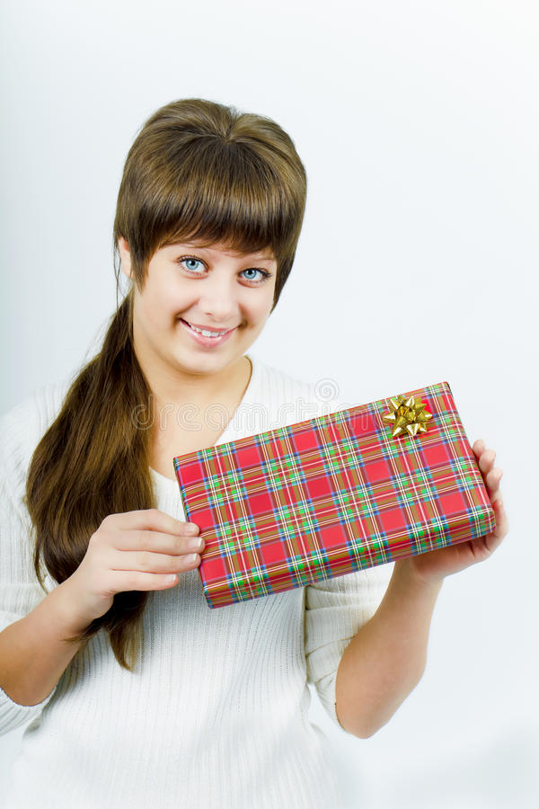 Download Young woman with a gift stock photo. Image of beauty - 17479826