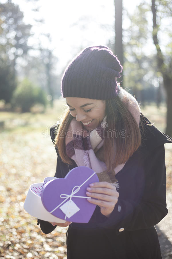 Download Young Woman With A Gift In Their Hands Stock Image - Image: 83723271