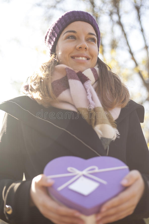 Download Young Woman With A Gift In Their Hands Stock Photo - Image: 83723499