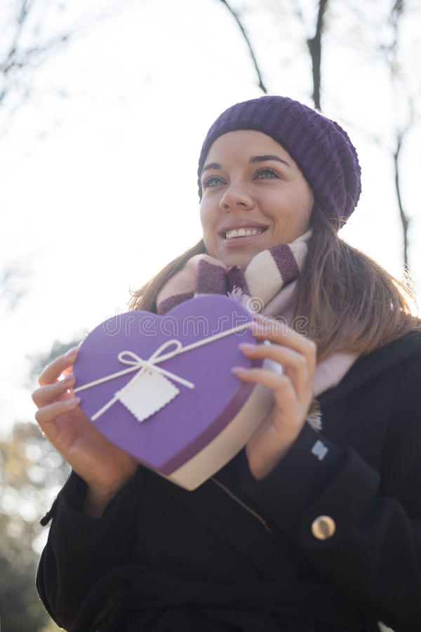 Download Young Woman With A Gift In Their Hands Stock Photo - Image: 83724074