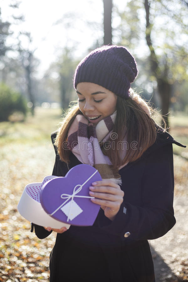 Download Young Woman With A Gift In Their Hands Stock Image - Image: 83724125
