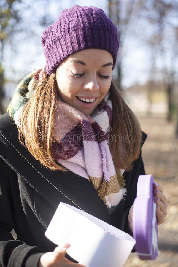 Download Young Woman With A Gift In Their Hands Stock Image - Image: 83724157