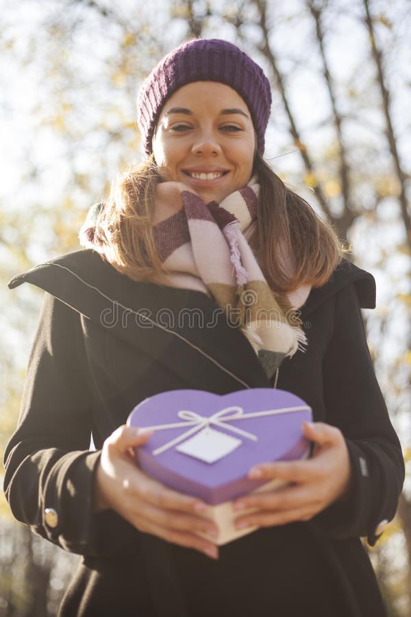 Download Young Woman With A Gift In Their Hands Stock Photo - Image of person, beautiful: 83724234