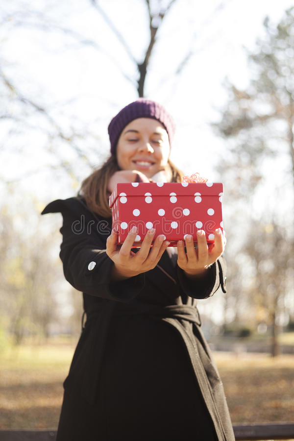 Download Young Woman With A Gift In Their Hands Stock Photo - Image: 83724267