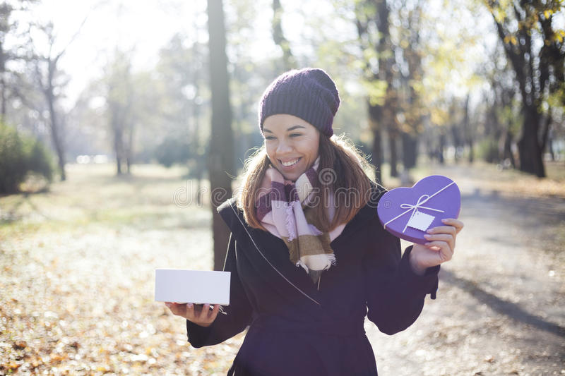 Download Young Woman With A Gift In Their Hands Stock Photo - Image: 83724551