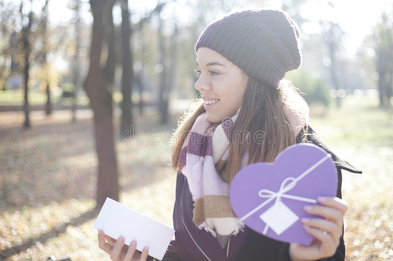 Download Young Woman With A Gift In Their Hands Stock Image - Image: 83724577