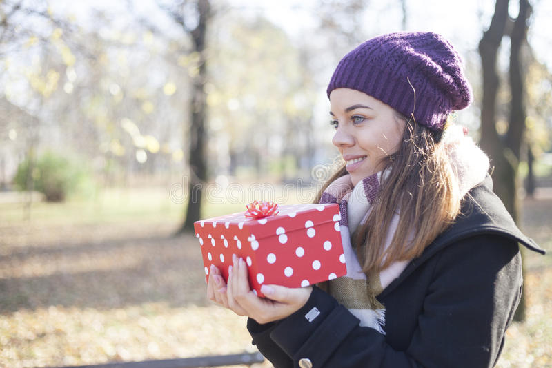 Download Young Woman With A Gift In Their Hands Stock Photo - Image: 83724620