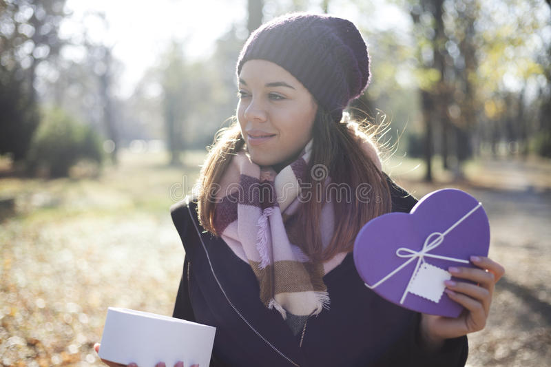 Download Young Woman With A Gift In Their Hands Stock Photo - Image: 83724820